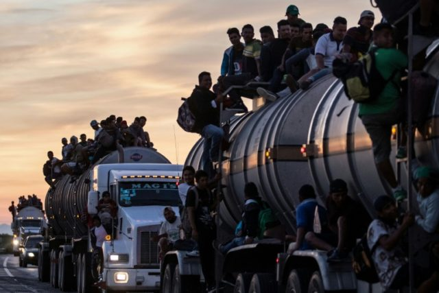 A truck carrying mostly Honduran migrants taking part in a caravan heading to the US drives from Santiago Niltepec to Juchitan near the town of La Blanca in Oaxaca State Mexico