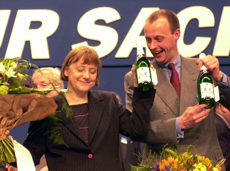 Angela Merkel stands alongside her party's parliamentary group leader Friedrich Merz after being elected as the new leader of Christian Democratic Union in Apri9l 2000