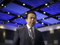 In this July 4, 2017 file photo, Interpol President, Meng Hongwei, walks toward the stage to deliver his opening address at the Interpol World congress in Singapore. A French judicial official says Friday Oct.5, 2018 the president of Interpol has been reported missing after traveling to China. (AP Photo/Wong Maye-E, …