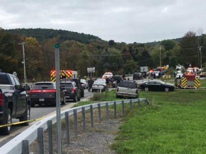 AP source: Tourist-spot crash kills 18 in limo, 2 bystanders