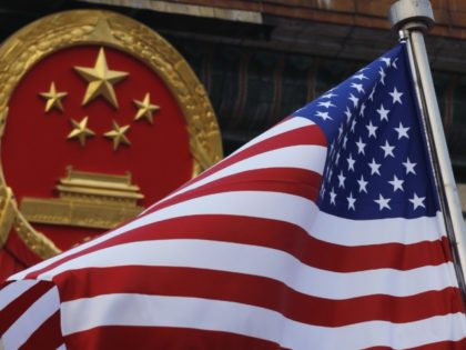 "In this Nov. 9, 2017, file photo, an American flag is flown next to the Chinese national emblem during a welcome ceremony for visiting U.S. China says accusations against an alleged spy of attempting to steal trade secrets from several American aviation and aerospace companies were ""made out of thin …"