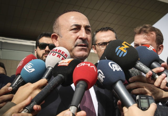 Turkey's Foreign Minister Mevlut Cavusoglu speaks to the media after a meeting with U.S. Secretary of State Mike Pompeo at the Esenboga Airport in Ankara, Turkey, Wednesday, Oct. 17, 2018. Pro-government newspaper Yeni Safak on Wednesday said it had obtained audio recordings of the alleged killing of Saudi writer Jamal …