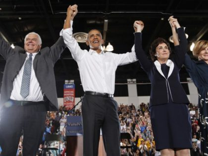 Former President Barack Obama, second from left, cheers at a rally in support of candidate for Senate Jacky Rosen, second from right, Clark County Commission Chair and Democratic gubernatorial candidate Steve Sisolak, left, and Susie Lee, Democratic candidate for Nevada's third congressional district, right, and other Nevada Democrats, Monday, Oct. …