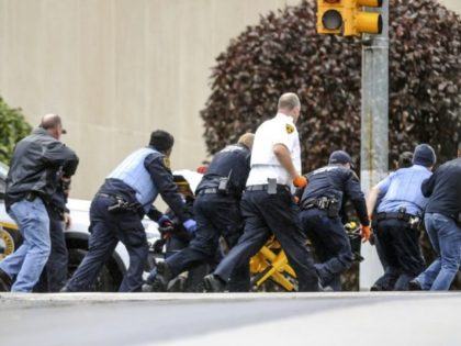 The Latest: Feds to file hate-crime charges in shooting