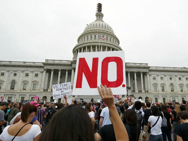 Activists demonstrate in the plaza of the East Front of the U.S. Capitol to protest the confirmation vote of Supreme Court nominee Brett Kavanaugh on Capitol Hill, Saturday, Oct. 6, 2018 in Washington. (AP Photo/Alex Brandon)