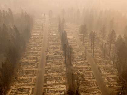 (AP) —Cool weather helped fire crews gain ground Thursday against …