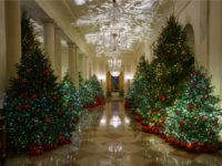 The Cross Hall is seen during the 2018 Christmas Press Preview at the White House in Washington, Monday, Nov. 26, 2018. Christmas has arrived at the White House. First lady Melania Trump unveiled the 2018 White House holiday decor on Monday. She designed the decor, which features a theme of …