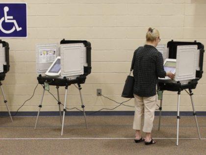 9a4329_georgia-runoff-governor-88528-voter-casts-her-ballot-georgia-primary-election