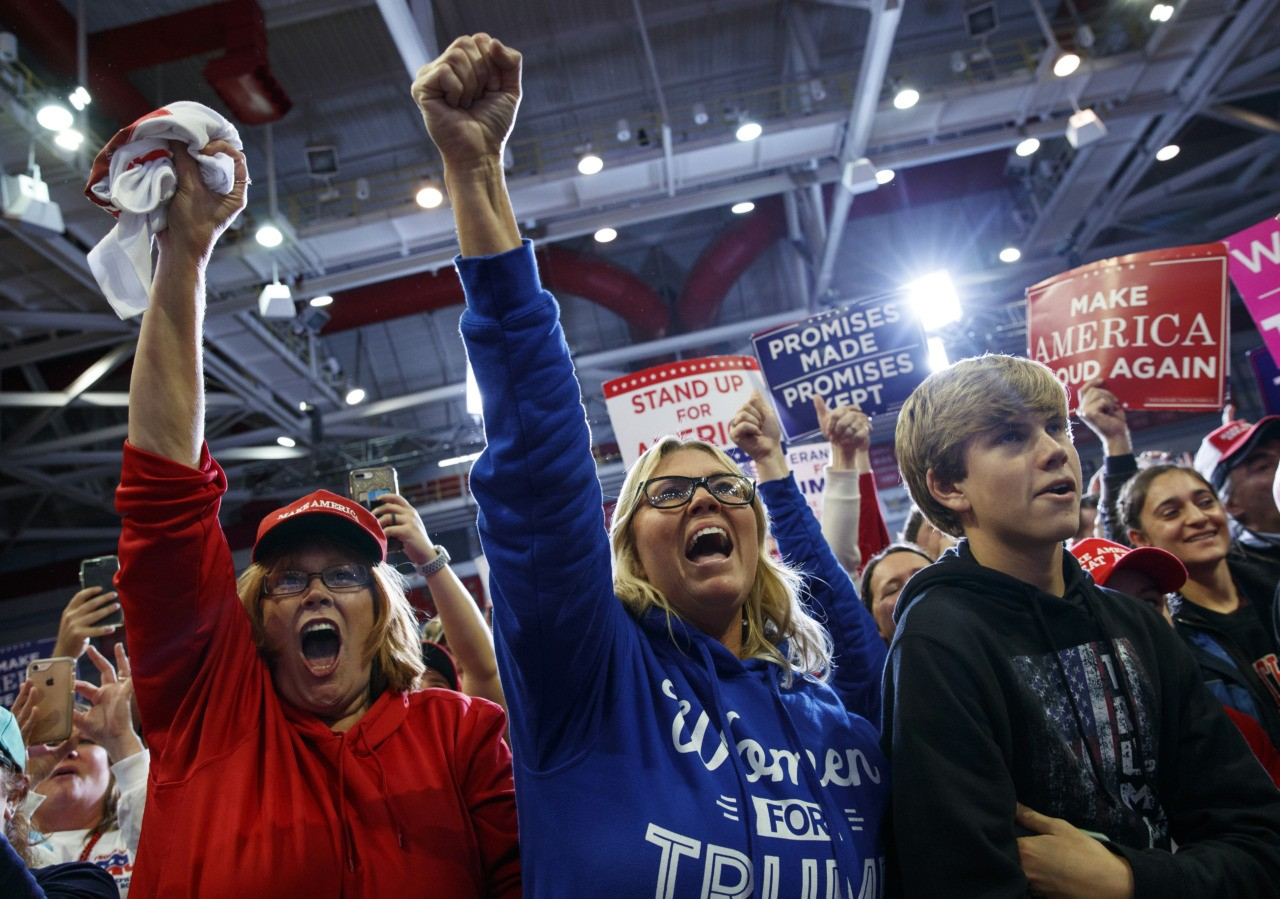 Supporters of President Donald Trump cheer as the president arrives to speak during a rally at Show Me Center, Monday, Nov. 5, 2018, in Cape Girardeau, Mo.. (AP Photo/Carolyn Kaster)