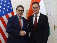 Hungarian Minister of Foreign Affairs and Trade Peter Szijjarto, right, welcomes US Secretary of Energy Rick Perry at the Ministry of Foreign Affairs and Trade in Budapest, Hungary, Tuesday, November 13, 2018. (Lajos Soos/MTI via AP)