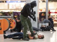 In this Nov. 20, 2018 photo a man acting as a terrorist shoots a mock victim during an anti-terror exercise at the Cologne-Bonn-airport in Cologne, western Germany. About 1 000 police and rescue staff trained how to react on a terror attack in the so far biggest exercise on a …