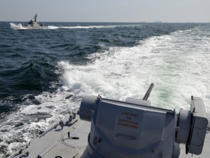 In this file photo taken and distributed by Ukrainian Navy Press Service on Sunday, Nov. 25, 2018, two Ukrainian forces navy ships are seen near Crimea. The Ukrainian navy says a Russian coast guard vessel rammed a Ukrainian navy tugboat near Crimea, damaging the ship's engines and hull. (Ukrainian Navy …
