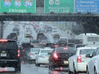 Heavy traffic is seen on Interstate 190 near O'Hare International Airport in Chicago, Sunday, Nov. 25, 2018. A winter storm is expected to dump snow across the Midwest, on one of the busiest travel days of the year. (AP Photo/Nam Y. Huh)