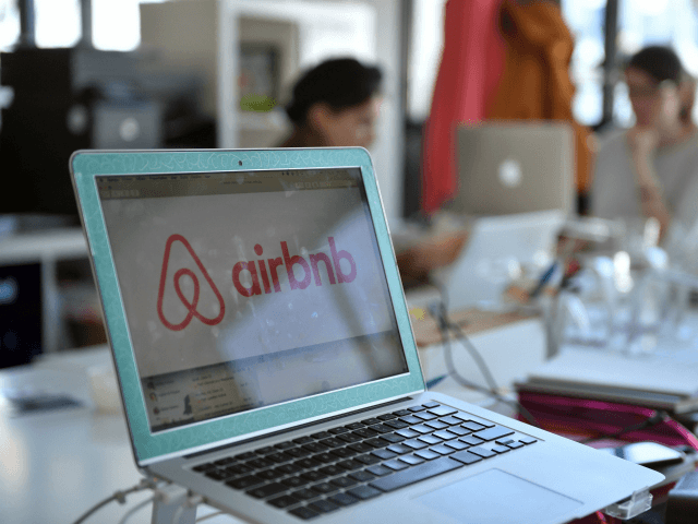 A picture shows the logo of online lodging service Airbnb displayed on a computer screen in the Airbnb offices in Paris on April 21, 2015. AFP PHOTO / MARTIN BUREAU / AFP PHOTO / MARTIN BUREAU (Photo credit should read MARTIN BUREAU/AFP/Getty Images)