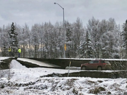 A car is trapped on a collapsed section of the offramp off of Minnesota Drive in Anchorage, Friday, Nov. 30, 2018. Back-to-back earthquakes measuring 7.0 and 5.8 rocked buildings and buckled roads Friday morning in Anchorage, prompting people to run from their offices or seek shelter under office desks, while …