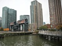 "A former dock facility is shown with old transfer bridges, with ""Long Island"" painted in large letters at Gantry State Park in the Long Island City section of Queens, N.Y., Tuesday Nov. 13, 2018, in New York. Amazon announced Tuesday it has selected the Queens neighborhood as one of two …"