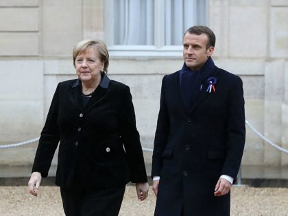 German Chancellor Angela Merkel (L) and French President Emmanuel Macron arrive to attend a lunch at the Elysee Palace in Paris on November 11, 2018 during commemorations marking the 100th anniversary of the 11 November 1918 armistice, ending World War I. (Photo by Jacques Demarthon / AFP) (Photo credit should …