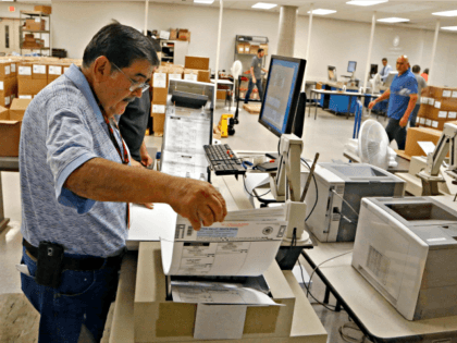 House 2016 Arizona 5th District An Arizona elections official at the Maricopa County Recorder's Office inserts ballots into a machine to recount the votes in the 5th Congressional District race Tuesday, Sept. 13, 2016, in Phoenix. Arizona officials on Tuesday began counting thousands of ballots in the razor-thin Republican primary …