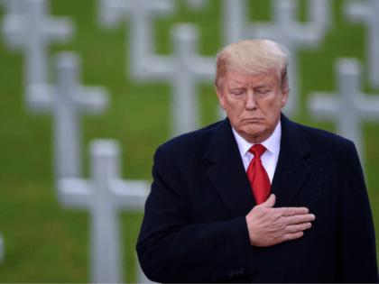 Trump Pays Tribute to 'Great Warriors' Who Fell in First World War at Rain-lashed Armistice Centenary
