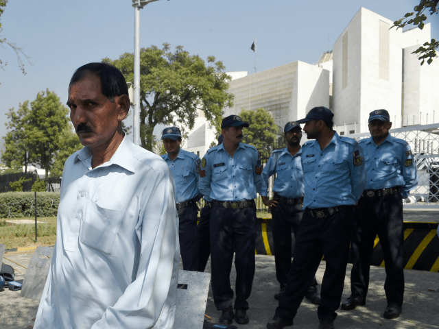 Ashiq Masih,(L), husband of Christian woman Asia Bibi who faces the death sentence for blasphemy, leaves the Supreme Court in Islamabad on October 13, 2016. Pakistan's Supreme Court delayed an appeal into the country's most notorious blasphemy case, against a Christian mother on death row since 2010, after one of …