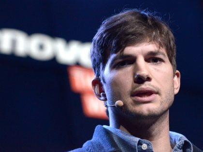 US actor Ashton Kutcher presents Lenovo's first multi mode tablet Yoga Tablet during Lenovo, a Chinese computer maker, press conference at Youtube Space on October 29, 2013 in Los Angeles, California.AFP PHOTO/JOE KLAMAR (Photo credit should read JOE KLAMAR/AFP/Getty Images)
