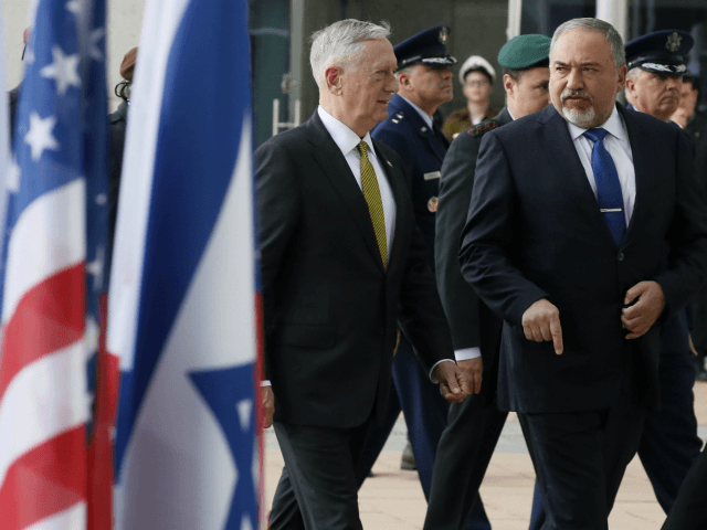 Israel's Minister of Defense Avigdor Lieberman (R) and U.S. Defense Secretary James Mattis (C) walk together after an honor cordon on April 21, 2017 in Tel Aviv, Israel. (Photo by Jonathan Ernst - Pool / Getty Images)