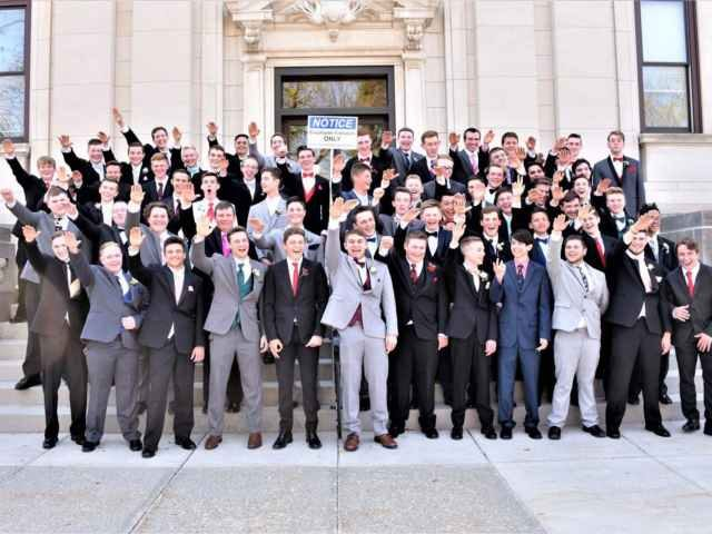 Baraboo HS pre-prom picture in which students appear to perform Nazi salutes