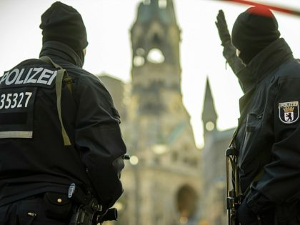 TOPSHOT - Policemen stand guard on December 21, 2016 near the Kaiser-Wilhelm-Gedaechtniskirche (Kaiser Wilhelm Memorial Church) in Berlin, close to the site where a truck crashed into a Christmas market two days before. Twelve people were killed and almost 50 wounded, 18 seriously, when the lorry tore through the crowd …