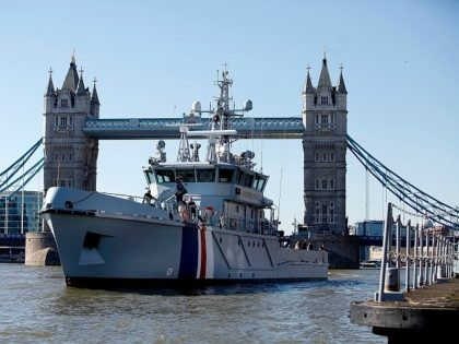 LONDON, ENGLAND - MARCH 16: The new Border Force cutter HMC Protector prepares to dock in front of Tower Bridge after arriving for her official launch on March 16, 2014 in London, England. The cutter, will be launched by the Home Secretary Theresa May MP on March 17, 2014, is …