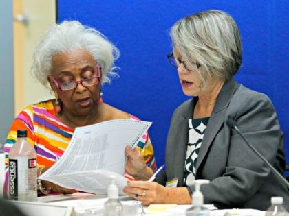 Dr. Brenda Snipes, left, Broward County Supervisor of Elections, looks at a ballot with Betsy Benson, canvasing board chair during a canvasing board meeting Friday, Nov. 9, 2018, in Lauderhill, Fla. The deeply purple state will learn Saturday afternoon whether there will be recounts in the bitter and tight U.S. …