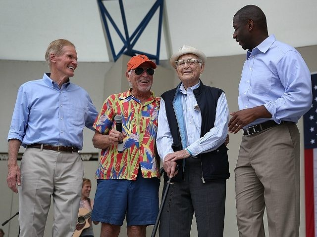 WEST PALM BEACH, FLORIDA - NOVEMBER 03: U.S. Senator Bill Nelson (D-FL) (L) and Florida Democratic governor candidate Andrew Gillum (R) stand on stage with Jimmy Buffett (2nd L) and Norman Lear during a Get Out the Vote rally at the Meyer Amphitheatre on November 03, 2018 in West Palm …
