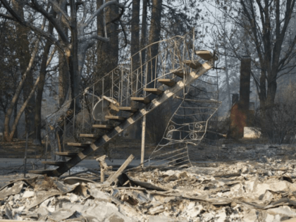 Only a staicase remains of a two story building in Paradise, Calif., on November 17. The Camp Fire, California's worst and deadliest, was declared 100 percent contained Sunday. Photo by Terry Schmitt/UPI