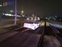 Driver stuck on train tracks after following GPS