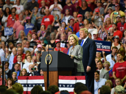 Senator Cindy Hyde-Smith (L) stands on stage with US President Donald Trump at a 'Make America Great Again' rally at Landers Center in Southaven, Mississippi, on October 2, 2018. (Photo by MANDEL NGAN / AFP) (Photo credit should read MANDEL NGAN/AFP/Getty Images)