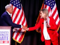 Appointed U.S. Sen. Cindy Hyde-Smith, R-Miss., right, and Democrat Mike Espy shake hands following their televised Mississippi U.S. Senate debate in Jackson, Miss., Tuesday, Nov. 20, 2018. (AP Photo/Rogelio V. Solis, Pool)
