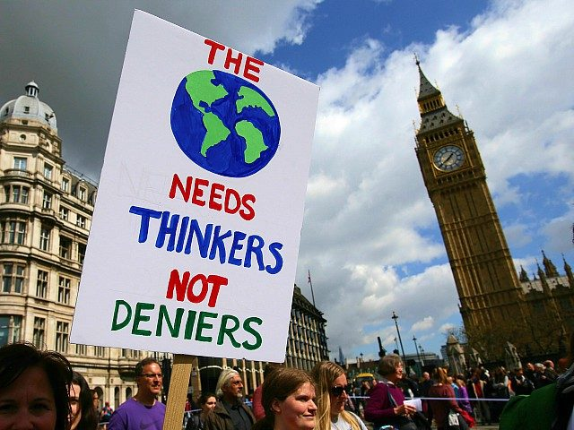 A protestor holds a placard as scientists and science enthusiasts participate in the 'March for Science' which celebrates the scientific method, in Westminster, central London on April 22, 2017, Earth Day. Thousands of people rallied in support for science in Europe and Australasia on April 22, ahead of a march …
