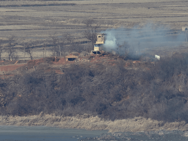 A North Korean guard post in the border county of Kaepoong is seen from a South Korean observation post in Paju near the Demilitarized Zone dividing two Koreas on January 8, 2016. South Korea on January 8 resumed high-decibel propaganda broadcasts into North Korea as the United States ramped up …