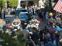 A law enforcement motorcade escorts the body of Ventura County Sheriff's Department Sgt. Ron Helus from the Los Robles Regional Medical Center Thursday, Nov. 8, 2018, in Thousand Oaks, Calif., after a gunman opened fire Wednesday night inside a country music bar killing multiple people including Helus.