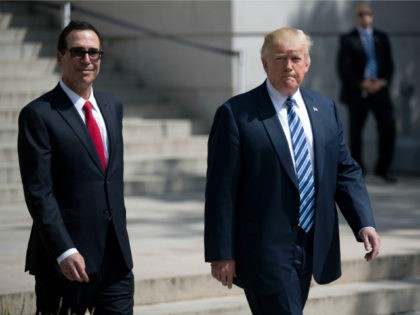 US President Donald J. Trump (R) and Secretary of Treasury Steven Mnuchin (L) walk out of the Treasury Department after a financial services Executive Order signing ceremon on April 21, 2017 in Washington, DC. President Trump is making his first visit to the Treasury Department for a memorandum signing ceremony …