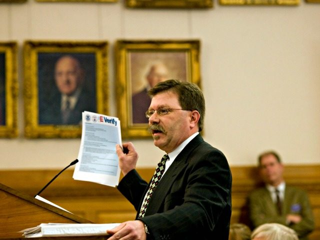 Businessman Chris Barbee holds up a copy of instructions for the E-Verify system at the Statehouse in Topeka, Kan., Wednesday, Feb. 27, 2008. Barbee explained to senators that the electronic process to verify a potential workers citizenship was straightforward and simple to use.