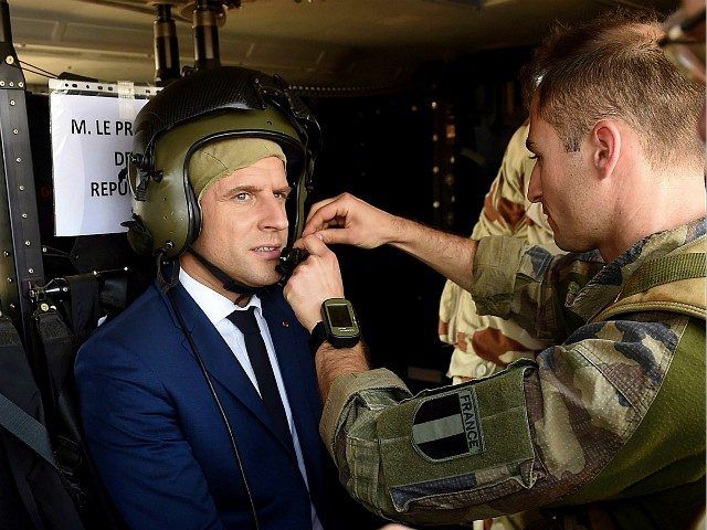 French President Emmanuel Macron (C) gears on for flying over Gao during a visit to the troops of France's Barkhane counter-terrorism operation in Africa's Sahel region in Gao, northern Mali, on May 19, 2017. Macron arrived on May 19 in conflict-torn Mali to visit French troops fighting jihadists on his …
