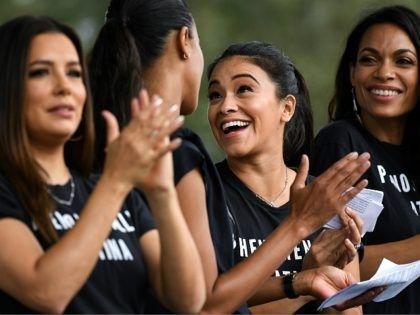 KISSIMMEE, FLORIDA - NOVEMBER 04: Eva Longoria, Zoe Saldaña, Gina Rodriguez and Rosario Dawson on stage during a campaign event attended by Senator Bill Nelson, at the 65th Infantry Veterans Park on November 4, 2018 in Kissimmee Florida. Mr. Nelson is facing off against Republican Florida Governor Rick Scott for …