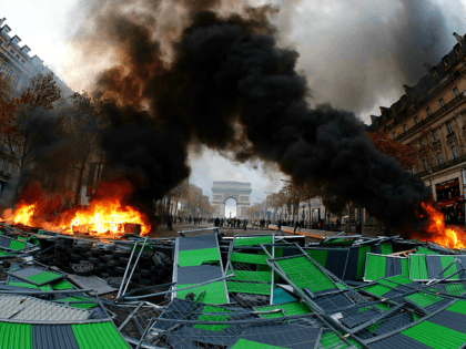 PICTURES: 'Yellow Jackets' Clash With Police as French Protest Macron's Fuel Tax Hikes