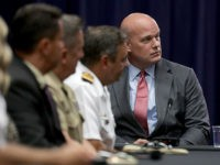 WASHINGTON, DC - AUGUST 29: Department of Justice Chief of Staff Matt Whitaker (R) participates in a round table event with the Joint Interagency Task Force - South (JIATF-S) foreign liaison officers at the Department of Justice Kennedy building August 29, 2018 in Washington, DC. Based in Key West, Florida, …