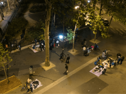 People sell and buy second-hand goods such as clothing, shoes, phones, phone chargers and DVDs at an illegal street vendor market, a semi-permanent market for the city's poor, on September 5, 2018 on Place de la Chapelle in Paris. (Photo by JOEL SAGET / AFP) (Photo credit should read JOEL …
