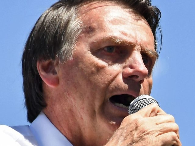 Brazilian right-wing presidential candidate Jair Bolsonaro speaks during a campaign rally in the district of Ceilandia in Brasilia, on September 5, 2018. - Brazil will hold presidential elections on October 7. (Photo by EVARISTO SA / AFP) (Photo credit should read EVARISTO SA/AFP/Getty Images)