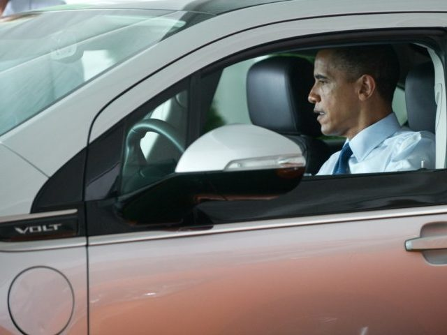 US President Barack Obama sits in an electric Chevrolet Volt following a groundbreaking ceremony for Compact Power's new advanced battery factory in Holland, Michigan, July 15, 2010. The plant will build batteries for electric vehicles including the Chevrolet Volt and Ford Focus. AFP PHOTO / Saul LOEB (Photo credit should …