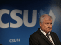 MUNICH, GERMANY - OCTOBER 15: Horst Seehofer, Chairman of the Christian Social Union (CSU), and Markus Soeder (not pictured), Governor of Bavaria and lead candidate of the CSU in yesterday's Bavarian state elections, speak to the media follwoing a meeting of the CSU leadership at party headquarters on October 15, …