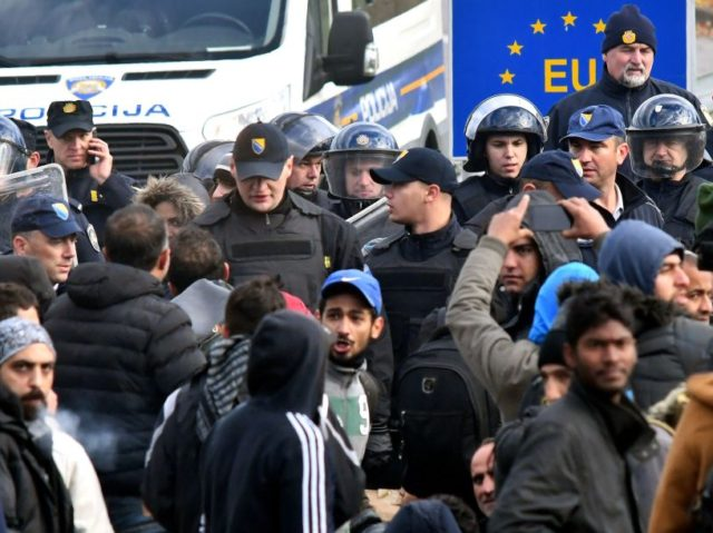 A group of approximately 100 Asian migrants face a police blockade, in the vicinity of Maljevac border crossing near Northern-Bosnian town of Velika Kladusa, on October 24, 2018. - Illegal migrants gathered near the border crossing in an attempt to cross into neighboring Croatia. Officers of Bosnian border police and …