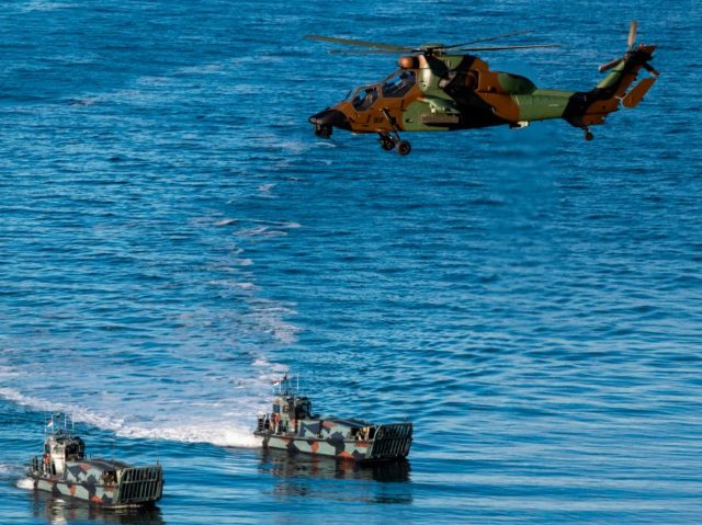 French Tigre attack helicopter supports Dutch Landing Crafts as they carry Finnish and Dutch Marines during a Joint demonstration as part of the NATO Trident Juncture 2018 exercise in Byneset near Trondheim, Norway, October 30, 2018. - Trident Juncture 2018, is a NATO-led military exercise held in Norway from 25 …